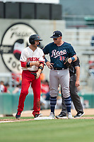 Fresno Grizzlies shortstop Carter Kieboom (8) talks to Kevin Cron (35) during a game against the Reno Aces at Chukchansi Park on April 8, 2019 in Fresno, California. Fresno defeated Reno 7-6. (Zachary Lucy/Four Seam Images)