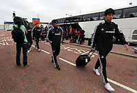 Wednesday 28 August 2013<br /> Pictured: Wayne Routledge (C) and Ki Sung Yueng (R) arriving at Cardiff Airport.<br /> Re: Swansea City FC players and staff en route for their UEFA Europa League, play off round, 2nd leg, against Petrolul Ploiesti in Romania.