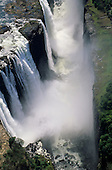 Victoria Falls, Zambia and Zimbabwe border. Aerial view; the waterfall in the gorge with spray mist.