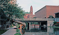 San Antonio:  Paseo del Rio, looking to Main Library and Bexar County Courthouse.  Photo '80.