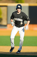 Evan Stephens (5) of the Wake Forest Demon Deacons takes his lead off of first base against the West Virginia Mountaineers at Wake Forest Baseball Park on February 24, 2013 in Winston-Salem, North Carolina.  The Demon Deacons defeated the Mountaineers 11-3.  (Brian Westerholt/Four Seam Images)
