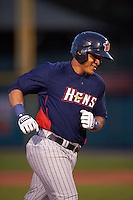 Toledo Mudhens third baseman Jefry Marte (33) runs the bases after hitting a grand slam home run during a game against the Rochester Red Wings on May 12, 2015 at Frontier Field in Rochester, New York.  Toledo defeated Rochester 8-0.  (Mike Janes/Four Seam Images)