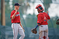 GCL Twins pitcher Niklas Rimmel (30) celebrates with catcher Jeferson Morales (2) after closing out a Gulf Coast League game against the GCL Pirates on August 6, 2019 at Pirate City in Bradenton, Florida.  GCL Twins defeated the GCL Pirates 4-2 in the first game of a doubleheader.  (Mike Janes/Four Seam Images)