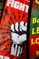 London, 01/05/2014. Thousands of people marched in central London to celebrate the International Workers' Day dedicated this year to the two great leaders, Bob Crow (General Secretary & leader of the Rail Maritime and Transport Union, RMT) and Tony Benn (Former Labour Cabinet Minister, Socialist and leading left-wing and anti-war campaigner), both passed away in March 2014. The rally started in Clerkenwell Green and ended in Trafalgar Square where speakers gave speeches remembering the two late leaders, in defence of worker's rights, in protest against the coalition Government spending cuts and policies, and in support and solidarity with the other demonstrations held around the world.