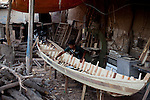 NAJAF, IRAQ: A young apprentice works in a boat making yard in the Najaf market...Daily life continues in relative peace in the Iraqi city of Najaf...Photo by Ali Arkady/Metrography