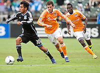 San Francisco, California - Saturday March 17, 2012: Rafael Baca dribbles away from Colin Clark and Je-Vaughn Watson during the MLS match at AT&T Park. Houston Dynamo defeated San Jose Earthquakes  1-0