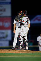 Rochester Red Wings pitcher Adam Bray (48) talks with catcher Wynston Sawyer (16) during an International League game against the Scranton/Wilkes-Barre RailRiders on June 24, 2019 at Frontier Field in Rochester, New York.  Rochester defeated Scranton 8-6.  (Mike Janes/Four Seam Images)