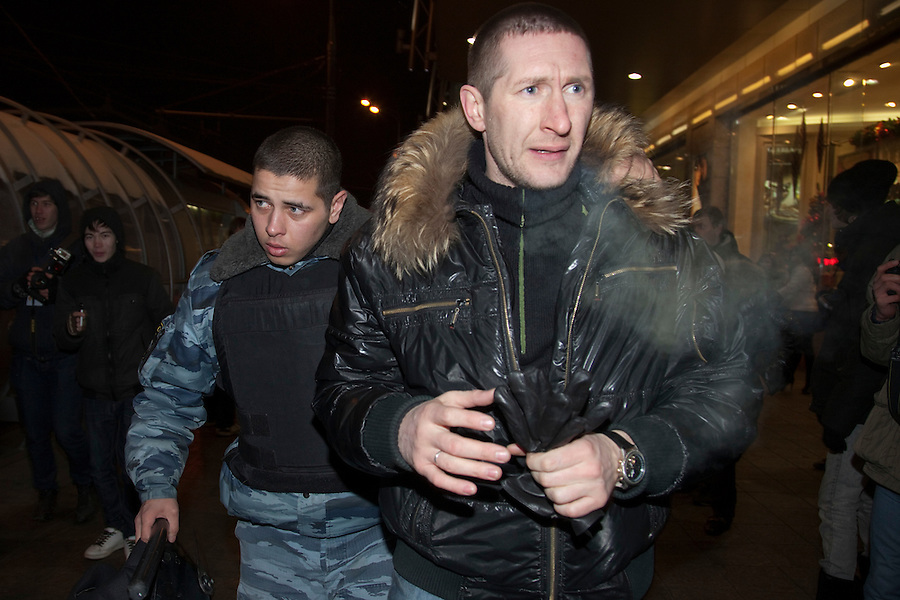Moscow, Russia, 15/12//2010..A riot policeman seizes a Russian nationalist near Kievsky railway station, where police detained up 1,000 people during an operation to prevent ethnic riots. There were scuffles as hundreds of riot police were deployed to prevent clashes between Russian nationalists and traders from the Caucasus, many of whom work at a market near the station.