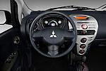 Steering wheel view of a 2012 Mitsubishi MiEV ES