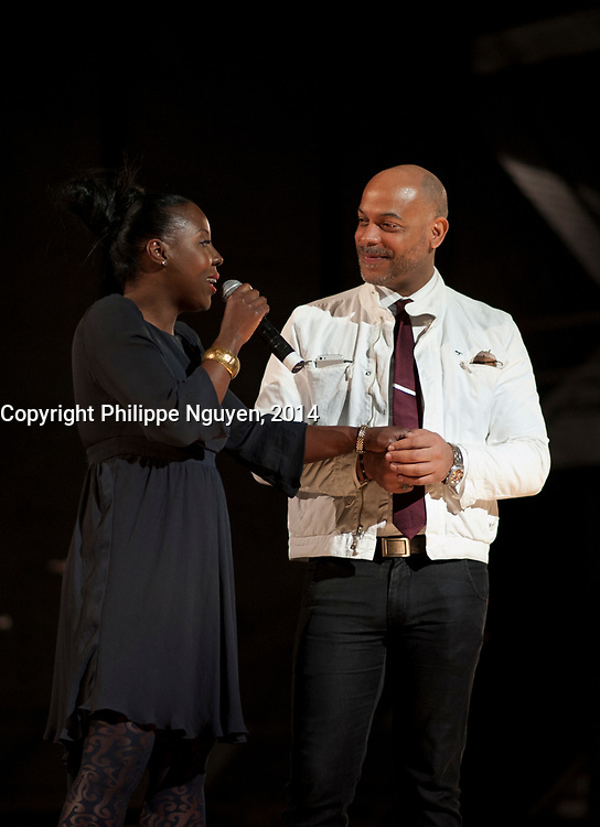 Dorothy Rau (L) and Philippe femiu, (R), co-presenters speak at Vues D'afriques (cinema festival)'s 30the anniversary at the Imperial Cinema in Montreal, Canada, April 25, 2014.<br /> <br /> Photo : Philippe Nguyen