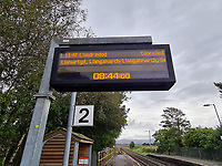 Pictured: Cancelled services on the screen at Llangennech Railway Station, Wales, UK. Thursday 27 August 2020<br /> Re: A freight train carrying diesel has derailed and burst into flames in Llangennech, near Llanelli, Wales, UK.<br /> People living nearby in Carmarthenshire, were evacuated but have since returned to their homes.<br /> Police declared a major incident, put a cordon in place and closed roads.<br /> The two workers who were on board the train have been accounted for and no injuries have been reported according  to the British Transport Police.