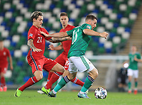 7th September 2020; Windsor Park, Belfast, County Antrim, Northern Ireland; EUFA Nations League, Group B, Northern Ireland versus Norway; Conor Washington of Northern Ireland and Norway's Mathias Normann compete for the ball