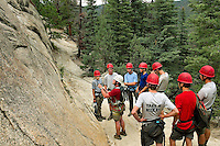Photo story of Philmont Scout Ranch in Cimarron, New Mexico, taken during a Boy Scout Troop backpack trip in the summer of 2013. Photo is part of a comprehensive picture package which shows in-depth photography of a BSA Ventures crew on a trek.  In this photo a BSA Venture Crew listens to instructions before starting  their climb to the top of  a natural surface rock at Cimarroncito Camp in the backcountry at Philmont Scout Ranch.   <br /> <br /> <br /> The  Photo by travel photograph: PatrickschneiderPhoto.com