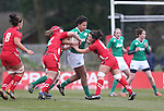 Wales pair Sian Williams and Carys Phillips stop Ireland lock Sophie Spence.<br /> 6 Nations Championship<br /> Wales v Ireland Women<br /> St Helens Swansea<br /> 15.03.15<br /> ©Steve Pope - SPORTINGWALES
