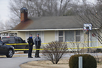 Officers stand by, Sunday, January 10, 2021 at the 720 NW 6th St. in Bentonville. Police officers shot and killed a man early Sunday morning during a domestic disturbance, according to a news release from the police department. Check out nwaonline.com/210111Daily/ for today's photo gallery. <br /> (NWA Democrat-Gazette/Charlie Kaijo)