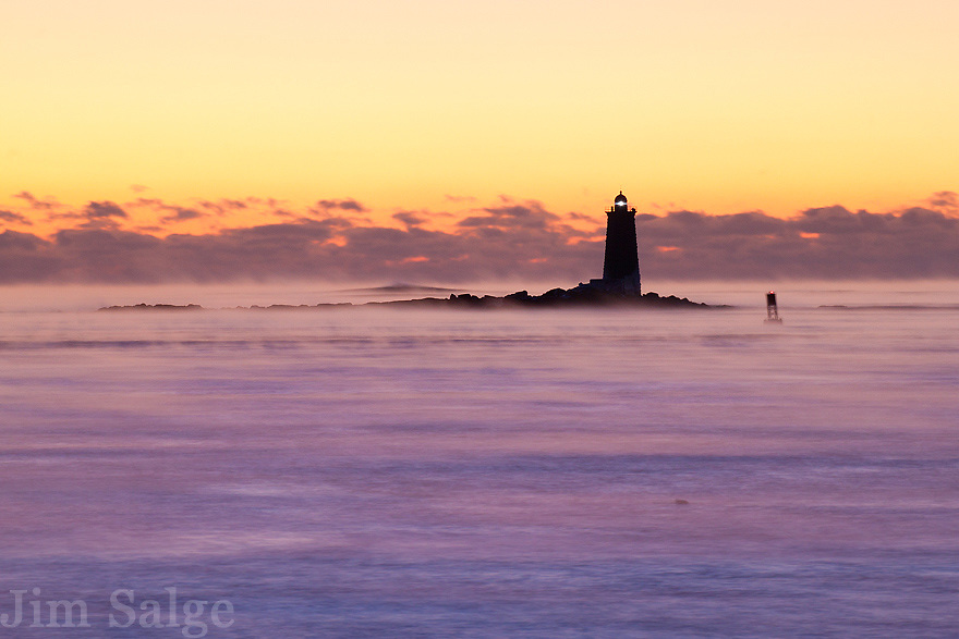 Before sunrise on this frigid morning in New Castle, New Hampshire, the ocean, covered in sea smoke turned a beautiful shade of purple.  The way the light changed over the next hour was one of the most beautiful things I've seen in the natural world!