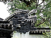 Dragons (Yang and Phoenix (Ying) are omnipresent i the garden.  Dragons are often playing with a pearl (ball).  Yu Gardens, a peaceful place to escape the bustle of Shanghai.  Full of visitors, still very calming.  Details in the buildings, doors and stone sculptures.  Helps get your Ying and Yang in balance.