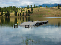 Sophie Lake in Northwest Montana. The water level so high launching ramps and docks are out in the water.