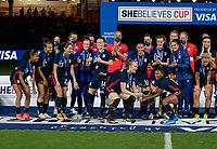 ORLANDO, FL - FEBRUARY 24: Becky Sauerbrunn #4 and Crystal Dunn #19 of the USWNT raise the SheBelieves Cup trophy after a game between Argentina and USWNT at Exploria Stadium on February 24, 2021 in Orlando, Florida.