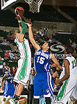 North Texas Mean Green forward Kedrick Hogans (24) and New Orleans Privateers guard Lenny Harmon (15) in action during the game between the New Orleans Privateers and the University of North Texas Mean Green at the North Texas Coliseum,the Super Pit, in Denton, Texas. UNT defeated UNO 78 to 47.....