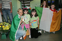 2/8/2010. Derval O'Rourke arrives back into Dublin Aiorport pictrured with fans Grainne 5 and Sarah 9 Hanley from Skryne Co Meath and Mathew 9 and Jessica 7 Brennan from Rathog Co Meath. European silver-medallist Derval O'Rourke has arrived home from Barcelona.O'Rourke finished second in the 100m hurdles on Saturday night to win her second European Athletics Championship silver medal. She was presented with her medal at the Olympic Stadium in Barcelona yesterday evening. Picture James Horan/Collins Photos.