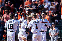 Alex McGarry (44) is congratulated by Ryan Ober (18), Micah McDowell (12), and Kyler McMahan (1) after hitting a home run during an NCAA game against the New Mexico Lobos at Surprise Stadium on February 14, 2020 in Surprise, Arizona. (Zachary Lucy / Four Seam Images)