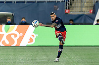 FOXBOROUGH, MA - NOVEMBER 20: Gustavo Bou #7 of New England Revolution passes the ball during the Audi 2020 MLS Cup Playoffs, Eastern Conference Play-In Round game between Montreal Impact and New England Revolution at Gillette Stadium on November 20, 2020 in Foxborough, Massachusetts.