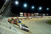 DARLINGTON, SOUTH CAROLINA - MAY 20: Denny Hamlin, driver of the #11 FedEx Delivering Strlength Toyota, leads a pack of cars during the NASCAR Cup Series Toyota 500 at Darlington Raceway on May 20, 2020 in Darlington, South Carolina. (Photo by Jared C. Tilton/Getty Images)