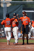 San Francisco Giants Matt Winn (12) fist bumps Phil Bickford (43) and Dylan Davis (35) after hitting a home run during an instructional league game against the Kansas City Royals on October 22, 2015 at the Giants Baseball Complex in Scottsdale, Arizona.  (Mike Janes/Four Seam Images)