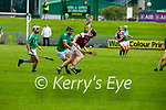 Causeway's Dan Goggin gets past David Goulding and Michael Boyle of Ballyduff in round 2 of the County Senior Hurling championship,