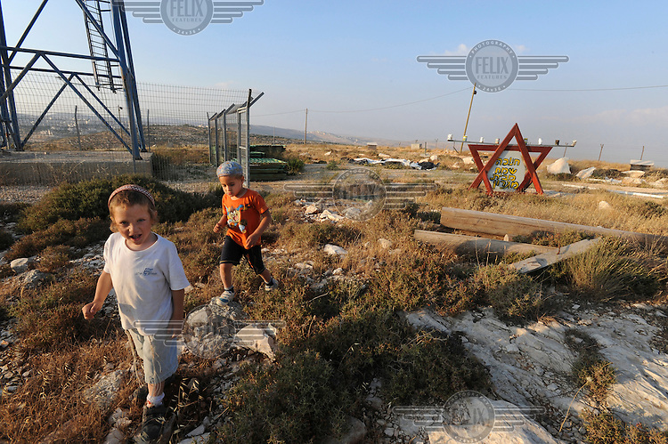 Kids wander around in the unauthorised Jewish settlement of Migron, one of 26 illegal outposts that the Israeli government decided to evacuate...