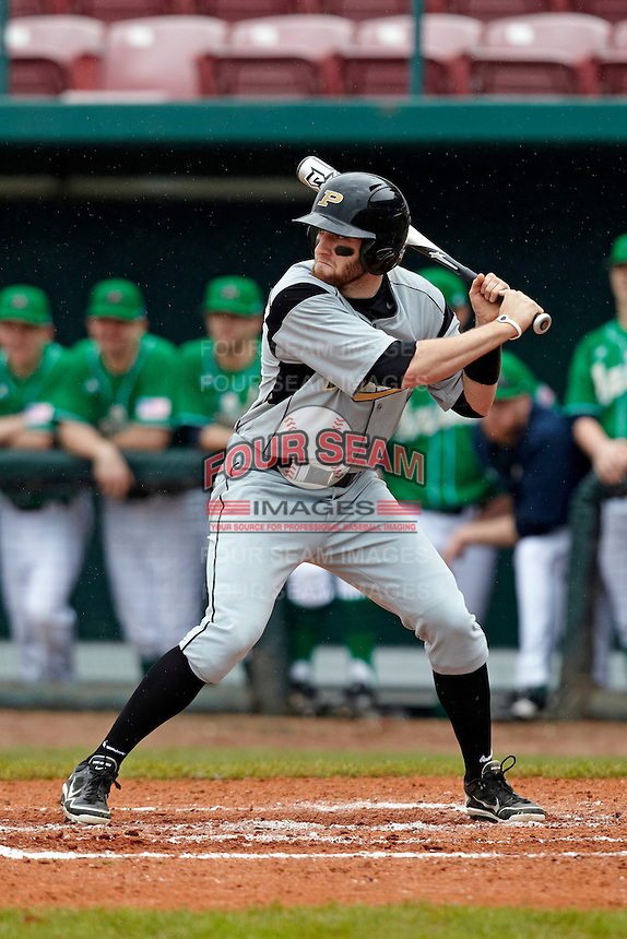 Purdue Boilermakers outfielder Andrew Dixon #11 at bat during a game against the Notre Dame Fighting Irish at the Big Ten/Big East Challenge at Al Lang Stadium on February 19, 2012 in St. Petersburg, Florida.  (Mike Janes/Four Seam Images)