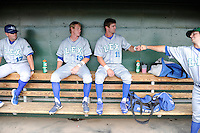 Outfielder Bubba Starling (11) of the Lexington Legends gets a fist bump in the dugout before a game against the Greenville Drive on Sunday, July 21, 2013, at Fluor Field at the West End in Greenville, South Carolina. From left are hitting coach Justin Gemoll (17) and Fred Ford (19). Starling is the No. 2 prospect of the Kansas City Royals and was the No. 5 overall pick in the first round of the 2011 First-year Player Draft. Lexington won, 2-0. (Tom Priddy/Four Seam Images)