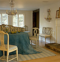 An Indian dhurrie is used as a tablecloth in this elegantly furnished dining room