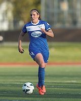 Boston Breakers defender Cat Whitehill (4) brings the ball forward.  In a National Women's Soccer League Elite (NWSL) match, the Boston Breakers (blue) defeated Chicago Red Stars (white), 4-1, at Dilboy Stadium on May 4, 2013.