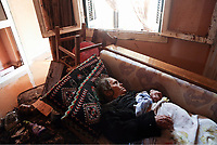 Pictured: An old woman is resting on a sofa after being found by the emergency services at her flooded house <br /> Re: Pictured:<br /> Re: Five people have reportedly died and severe damage caused by heavy rain and flash flooding in the area of Mandra, near Athens, Greece. Wednesday 15 November 2017