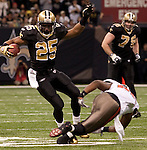 December 2009:  New Orleans Saints running back Reggie Bush (25) jukes a defender during an NFL football game at the Louisiana Superdome in New Orleans.  The Buccaneers defeated the Saints 20-17.