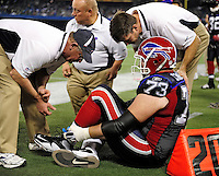 3 December 2009: Buffalo Bills' offensive tackle Kirk Chambers is checked out by team trainers after a play injury during a game against the New York Jets at the Rogers Centre in Toronto, Ontario, Canada. The Bills fell to the Jets 19-13. Mandatory Credit: Ed Wolfstein Photo