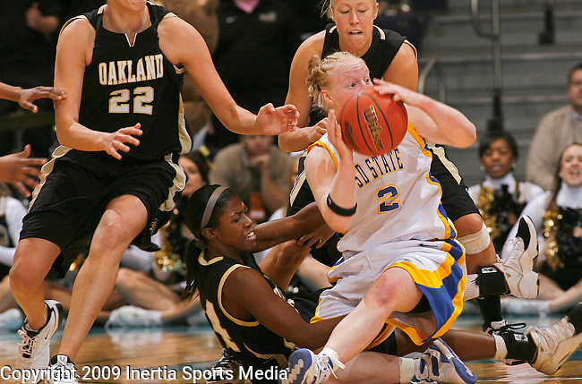SIOUX FALLS, SD - MARCH 10:  Macie Michelson #2 of South Dakota State looks for a teammate after grabbing a loose ball in front of Sharise Calhoun #34 (on floor) of Oakland University during the Summit League Championship women's basketball game Tuesday afternoon at the Sioux Falls Arena. (Photo by Dick Carlson/Inertia)