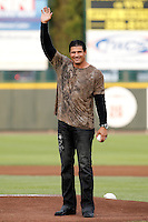 Former major leaguer Jose Canseco waves to the crowd before throwing out the first pitch at a game between the Rochester Red Wings and Lehigh Valley IronPigs at Frontier Field on August 18, 2011 in Rochester, New York.  Lehigh Valley defeated Rochester 11-1.  (Mike Janes/Four Seam Images)