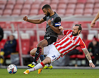 31st October 2020; Bet365 Stadium, Stoke, Staffordshire, England; English Football League Championship Football, Stoke City versus Rotherham United; Steven Fletcher of Stoke City tackles Michael Ihiekwe of Rotherham United