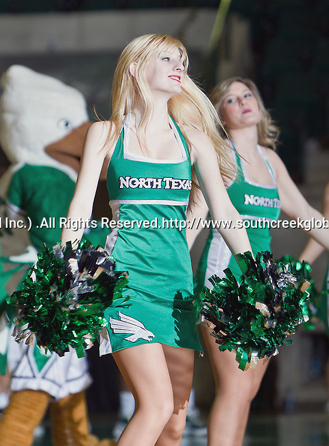 North Texas Mean Green cheerleaders in action during the game between the Louisiana Lafayette Ragin' Cajuns and the University of North Texas Mean Green at the North Texas Coliseum,the Super Pit, in Denton, Texas. UNT defeats Louisiana Lafayette 78 to 40....