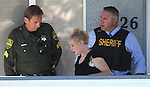 Carson City Sheriff's officials take Rachel Darlene Barrett, 30, into custody after she allegedly robbed a Nevada State Bank in Carson City, NV. on Tuesday, Oct. 11, 2011..Photo by Cathleen Allison