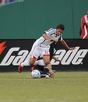 New England Revolution forward Brandon Manzonelli (32) gets fouled by DC United defender Bryan Namoff (26). DC United defeated The New England Revolution 3-1, on the Semifinal game of the Lamar Hunt U.S. Open Cup, Tuesday August 12, 2008 at RFK Stadium.
