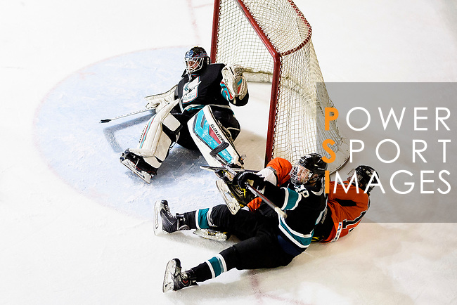 Charlie Huber of Cathay Flyers (C) fights for the puck with Devin Welsh of HK Tigers (R) during the Mega Ice Hockey 5s match between Cathay Flyers and HK Tigers on May 04, 2018 in Hong Kong, Hong Kong. Photo by Marcio Rodrigo Machado / Power Sport Images