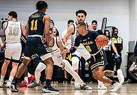 WASHINGTON, DC - FEBRUARY 22: Ayinde Hikim #0 of La Salle dribbles past Arnaldo Toro #11 of George Washington during a game between La Salle and George Washington at Charles E Smith Center on February 22, 2020 in Washington, DC.