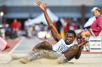 Lederrick Ward of SIU-Edwardsville lands in the sand pit in first round of long jump during West Preliminary Track & Field Championships at John McDonnell Field, Thursday, May 29, 2014 in Fayetteville, Ark. (Mo Khursheed/TFV Media via AP Images)