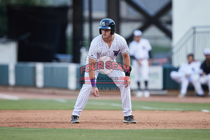 AJ Gill (7) of the Winston-Salem Dash takes his lead off of first base against the Greensboro Grasshoppers at Truist Stadium on June 15, 2021 in Winston-Salem, North Carolina. (Brian Westerholt/Four Seam Images)