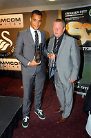 Pictured L-R: Goalkeeper Michel Vorm receiving Players' Player of The Year award by Marty Morgan. Thursday 10 May 2012<br /> Re: Swansea City FC awards dinner at the Liberty Stadium.