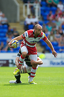 Charlie Sharples of Gloucester Rugby is tackled during the Aviva Premiership match between London Irish and Gloucester Rugby at the Madejski Stadium on Saturday 8th September 2012 (Photo by Rob Munro)